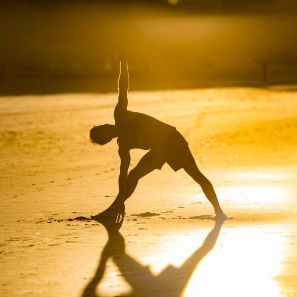Gay Yoga Instructor sunset