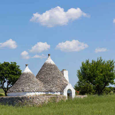 Traditional trulli drystone conical roof buildings
