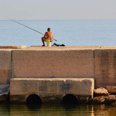Fishing from pier Molfetta Apulia Puglia Italy