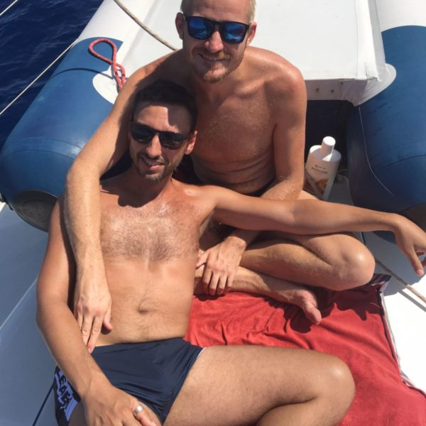 Chilling out on deck gay sailing